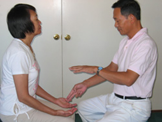 Master Ou was giving a one-on-one onsite healing session.